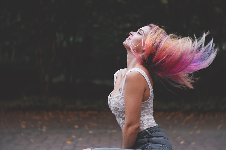 woman swinging hair with multiple colors