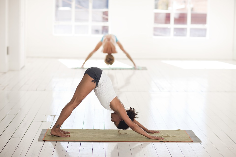 woman doing yoga wearing yoga clothes