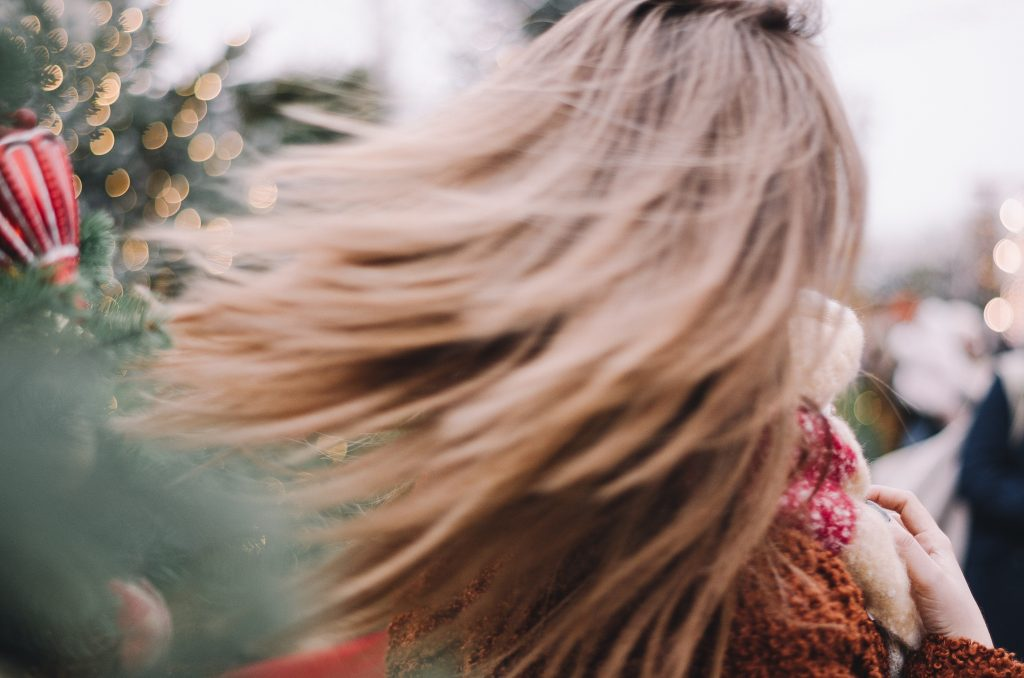 woman with hair swinging in christmas