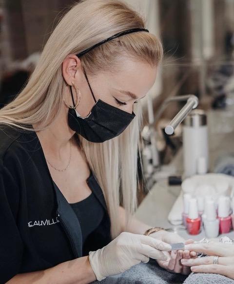 manicurist at montreal's salon deauville