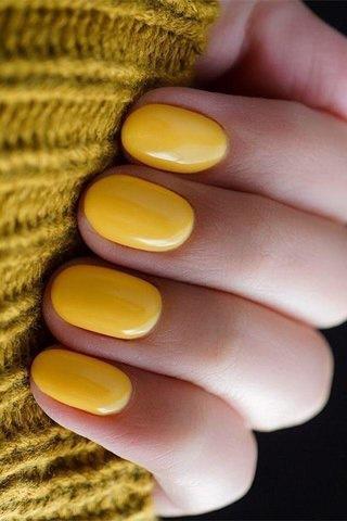 yellow nail polish manicure with nail art