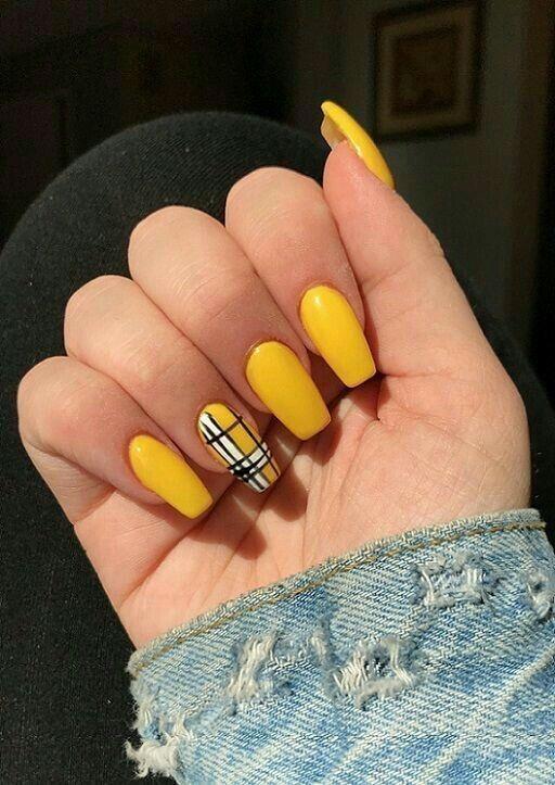 yellow finger nail polish with plaid nail art